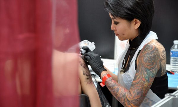 Girl Tattooing